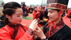 安徽亳州:百对新人参加汉服集体婚礼
